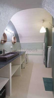 Pleasant bathroom with concrete floor