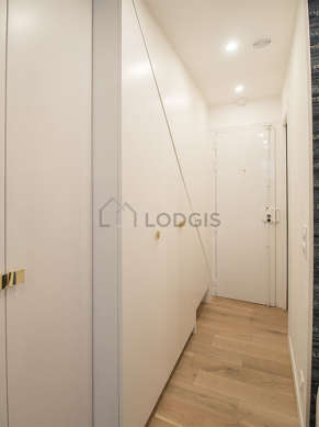 Very beautiful entrance with wooden floor and equipped with washing machine