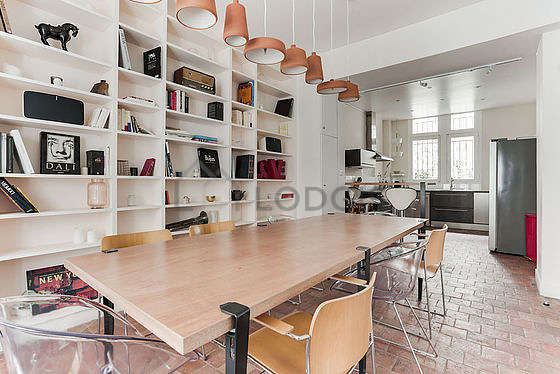 Dining room equipped with dining table, bookcase