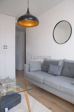 Very quiet living room furnished with tv, dvd player, fan, 1 chair(s)