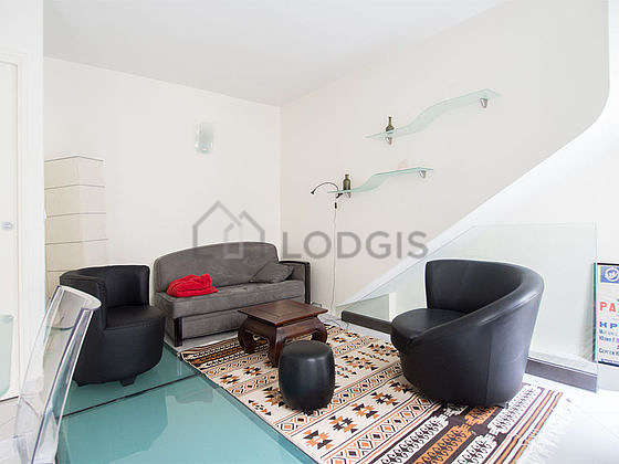 Very quiet living room furnished with sofa, 2 armchair(s)