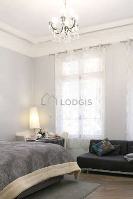 Very quiet living room furnished with 1 bed(s) of 160cm, tv, closet, storage space
