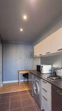 Kitchen equipped with washing machine, refrigerator, freezer, stool