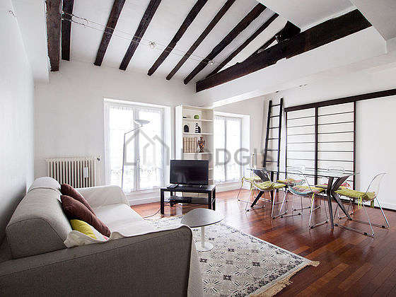Very quiet living room furnished with tv, 6 chair(s)