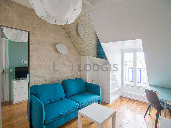 Very quiet living room furnished with 1 sofabed(s) of 140cm, tv, hi-fi stereo, closet