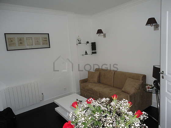 Bright living room furnished with cupboard, 1 chair(s)