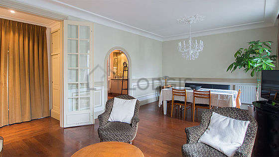 Quiet living room furnished with tv, 1 armchair(s), 7 chair(s)