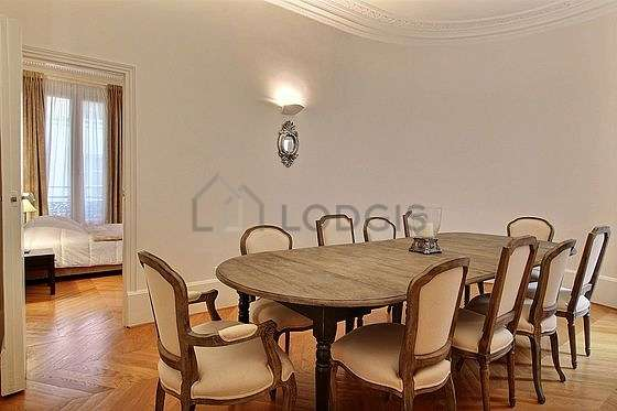 Great dining room with wooden floor for 10 person(s)