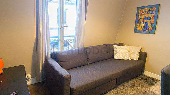 Very quiet living room furnished with 1 sofabed(s) of 150cm, tv, storage space, cupboard