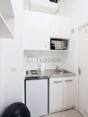 Kitchen where you can have dinner for 2 person(s) equipped with hob, dining table, crockery