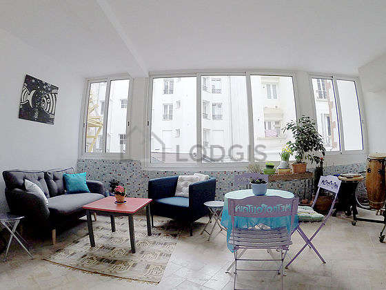 Very quiet and very bright veranda equipped with sofa, 1 armchair(s), cupboard
