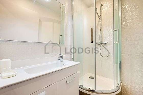 Pleasant and very bright bathroom with wooden floor