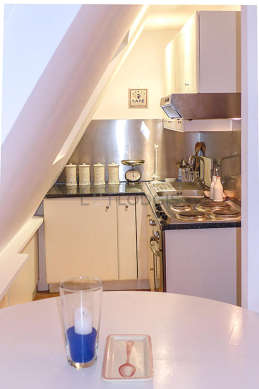 Kitchen equipped with refrigerator, extractor hood, crockery