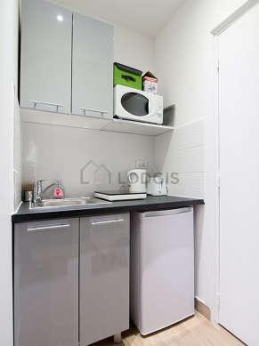 Kitchen equipped with washing machine, refrigerator