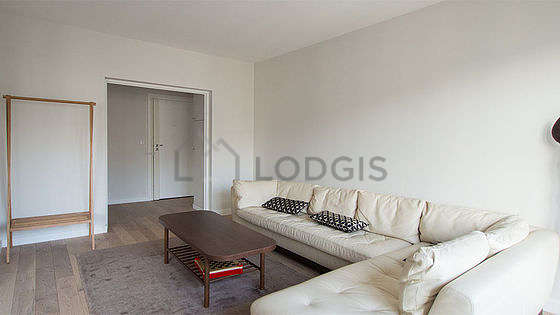 Very quiet living room furnished with sofa, coffee table