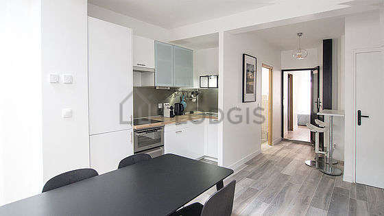 Kitchen where you can have dinner for 4 person(s) equipped with hob, refrigerator