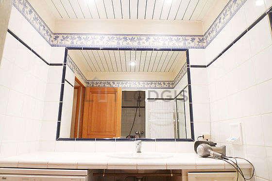 Very bright bathroom with tile floor