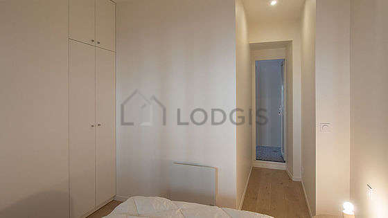 Bedroom equipped with cupboard, bedside table