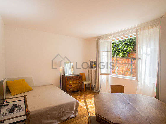 Very quiet living room furnished with dining table, wardrobe, 1 chair(s)