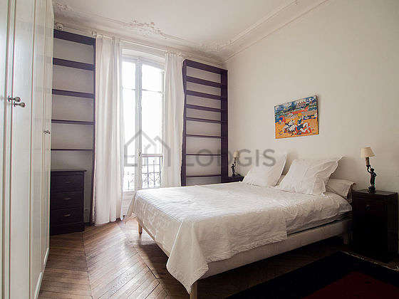 Very bright bedroom equipped with desk, wardrobe, cupboard, bedside table