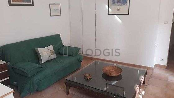 Quiet living room furnished with sofa, coffee table, cupboard, 1 chair(s)