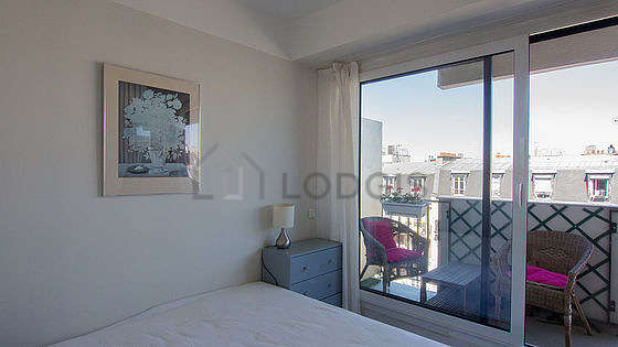 Bedroom with windows and balcony