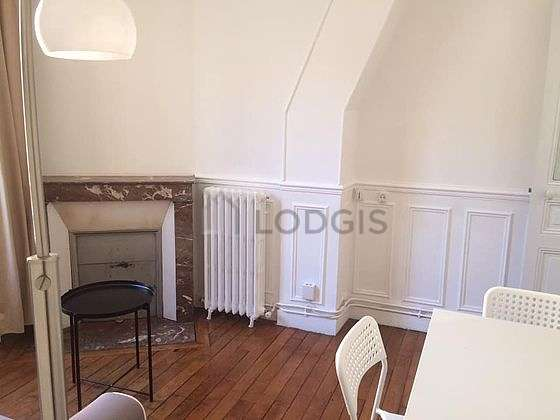 Very quiet living room furnished with tv, wardrobe, 1 chair(s)
