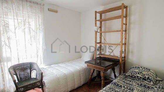 Bedroom with floor tiles floor