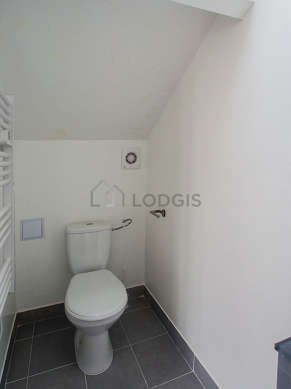 Pleasant and very bright bathroom with tile floor
