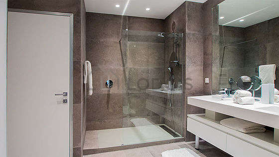 Pleasant bathroom with concrete floor