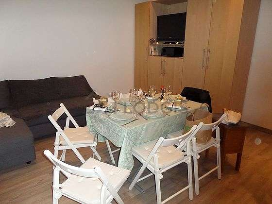 Very quiet living room furnished with 1 sofabed(s) of 140cm, dining table, cupboard, 6 chair(s)