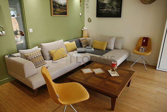 Quiet living room furnished with 1 murphy bed(s) of 140cm, tv, dvd player, wardrobe