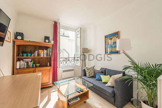 Very quiet living room furnished with tv, closet, cupboard