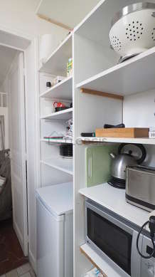 Kitchen equipped with washing machine, kettle