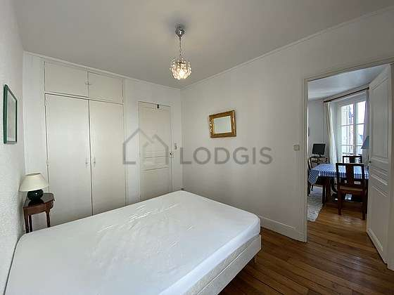 Very bright bedroom equipped with wardrobe, cupboard, 1 chair(s)
