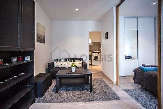 Living room furnished with 1 sofabed(s) of 140cm, tv, wardrobe