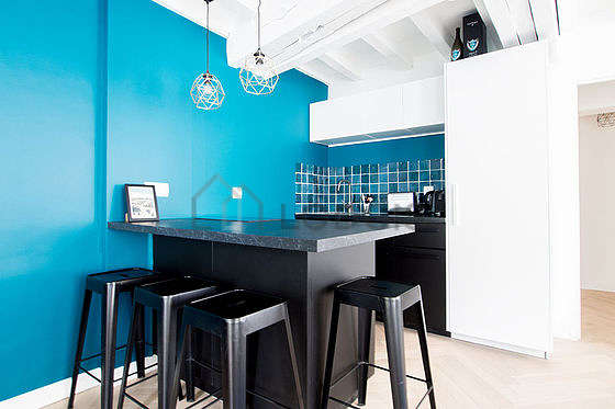 Kitchen where you can have dinner for 4 person(s) equipped with hob, refrigerator, crockery, stool