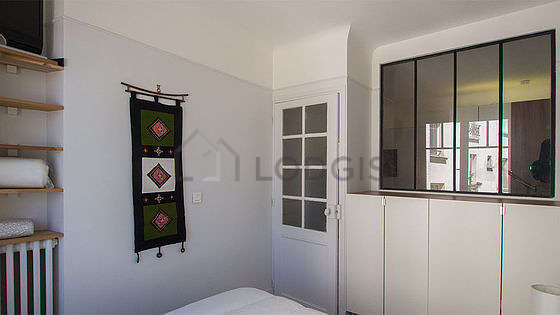 Very bright bedroom equipped with tv