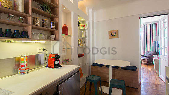 Kitchen where you can have dinner for 5 person(s) equipped with washing machine, refrigerator, crockery