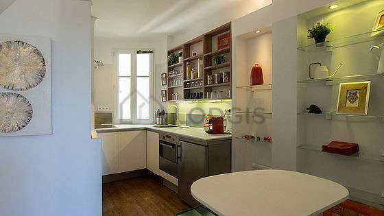 Bright kitchen facing the courtyard