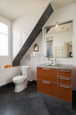 Bright bathroom with windows and with tile floor