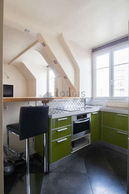 Kitchen where you can have dinner for 2 person(s) equipped with hob, refrigerator, cookware