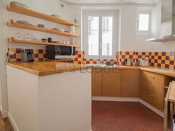 Magnifique cuisine de 5m² avec des tomettes au sol