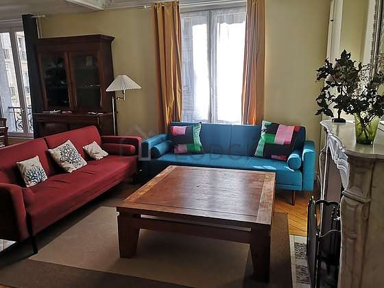 Very quiet living room furnished with 1 bed(s) of 90cm, tv, hi-fi stereo, 1 armchair(s)