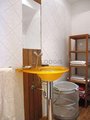 Bathroom equipped with washing machine, bath towels