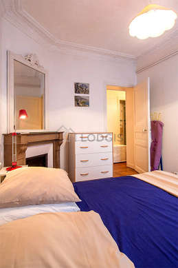 Bright bedroom equipped with wardrobe, cupboard, 1 chair(s)