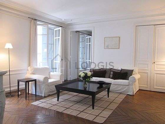 Quiet living room furnished with tv, dvd player, 1 armchair(s)