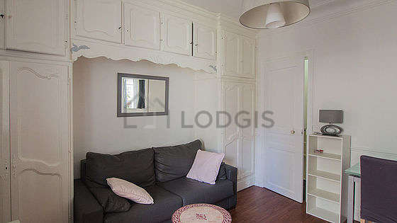 Bright living room furnished with wardrobe, cupboard, 2 chair(s)