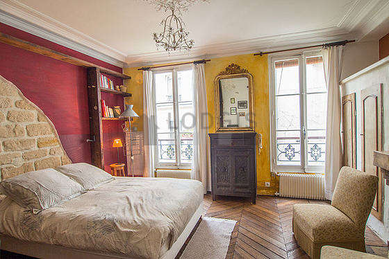 Chambre de 17m² avec du parquet au sol