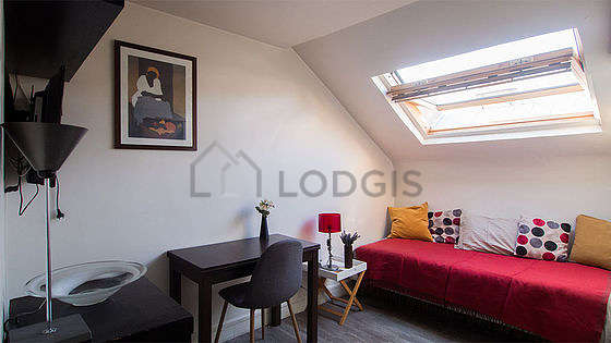 Very quiet living room furnished with 1 bed(s) of 90cm, tv, hi-fi stereo, wardrobe